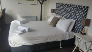 A bed or beds in a room at Fish Creek Hotel