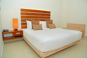A bed or beds in a room at Cloud 9 Boutique Hotel