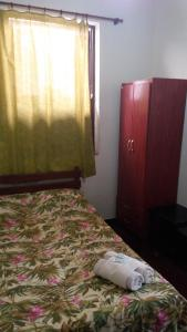 Cama ou camas em um quarto em Hotel Madrid