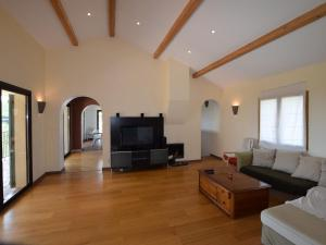 A seating area at Spacious Villa in Chiroubles with Swimming Pool