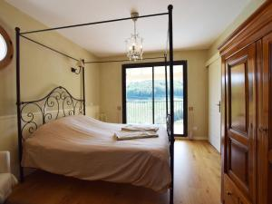 A bed or beds in a room at Spacious Villa in Chiroubles with Swimming Pool