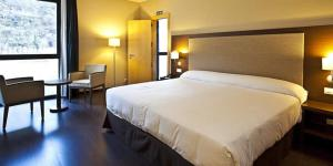 A bed or beds in a room at Balneario Elgorriaga