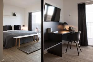 A bed or beds in a room at CPH Studio Hotel
