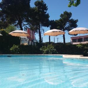 Het zwembad bij of vlak bij Rural Arco Iris