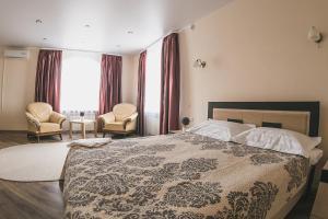 Кровать или кровати в номере Отель Классик