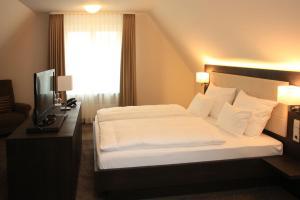 Ein Bett oder Betten in einem Zimmer der Unterkunft Alte Schmiede