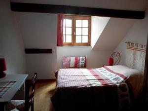 A bed or beds in a room at Gite duplex du vignoble Alsace