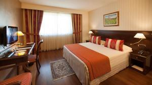 Letto o letti in una camera di Hotel Calissano