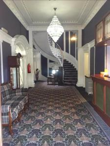 The lobby or reception area at The Tontine Hotel