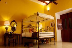 A bed or beds in a room at Hotel Boutique Casa Don Gustavo