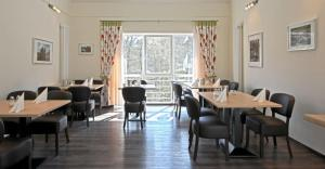 A restaurant or other place to eat at Haller Hotel Garni