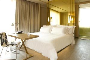 A bed or beds in a room at BOG Hotel a member of Design Hotels