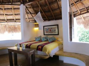 A bed or beds in a room at Amaranto Bed and Breakfast