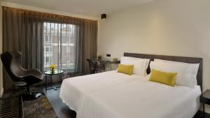 Een bed of bedden in een kamer bij Park Plaza London Waterloo