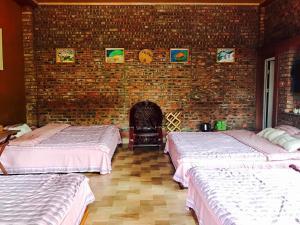 Giường trong phòng chung tại Lai Farm Ba Vi