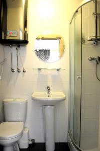 Ein Badezimmer in der Unterkunft Avantazh Hotel