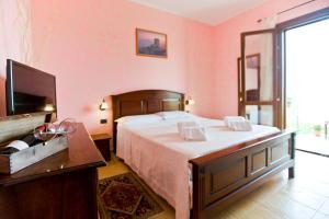 Letto o letti in una camera di History Hotel