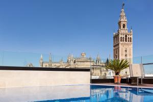 Piscina a Hotel Casa 1800 Sevilla o a prop