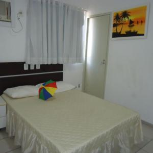 A bed or beds in a room at Flat Recife Quarto
