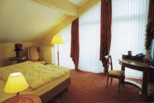 Ein Bett oder Betten in einem Zimmer der Unterkunft Flair Hotel Tannenhof