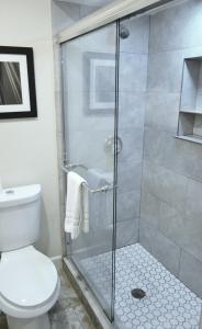 A bathroom at Rodeway Inn & Suites Ocean Beach