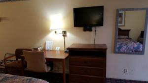 A television and/or entertainment center at Innkeeper Motel Hamel