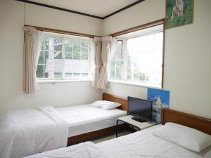 A bed or beds in a room at Yamaichiso