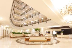 The lobby or reception area at Palasia Hotel
