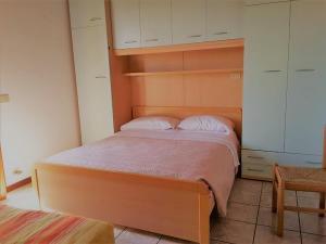Postel nebo postele na pokoji v ubytování Villaggio Laguna