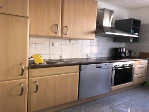 Küche/Küchenzeile in der Unterkunft White House Bochum II