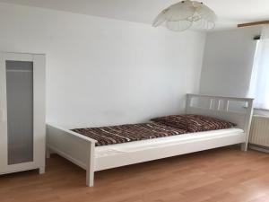 Ein Bett oder Betten in einem Zimmer der Unterkunft White House Bochum II