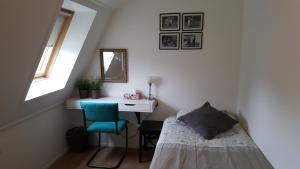 Een bed of bedden in een kamer bij De Oude Smidse