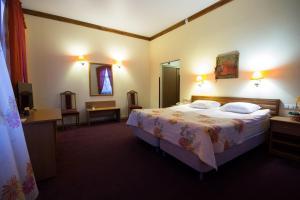 Кровать или кровати в номере Кошкин дом