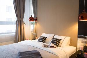 Letto o letti in una camera di A&A Premium Apartments