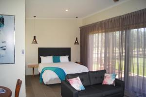 A bed or beds in a room at Manzanillo Grove Villa