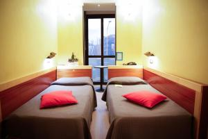 A bed or beds in a room at Art Hotel Milano