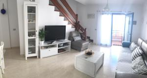 A television and/or entertainment center at Casa Alisios