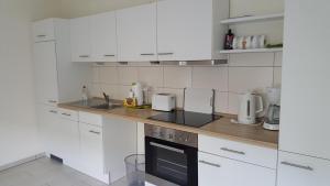 Küche/Küchenzeile in der Unterkunft Ferienwohnung Lühebogen