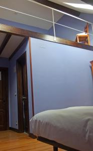 A bed or beds in a room at Posada de Roncesvalles