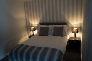 A bed or beds in a room at Kirks Korner Motel