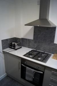 A kitchen or kitchenette at Kirks Korner Motel
