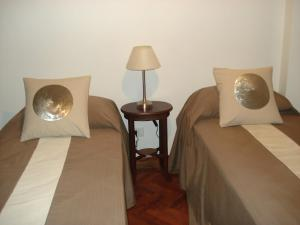 A bed or beds in a room at Tucuman Norte Apartment