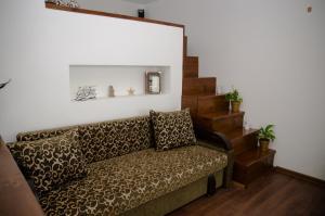 A seating area at Babylon Apartment on Bukovinskaya Street