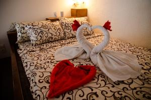 A bed or beds in a room at Babylon Apartment on Bukovinskaya Street