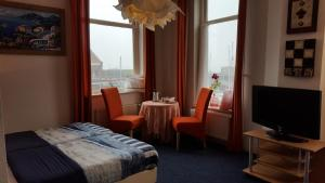 A bed or beds in a room at Hotel Ambiente
