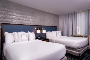 A bed or beds in a room at Fairfield Inn & Suites By Marriott New York Manhattan/Times Square