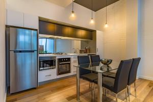 A kitchen or kitchenette at CBD Apartments