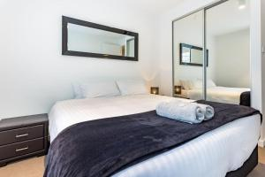 A bed or beds in a room at CBD Apartments