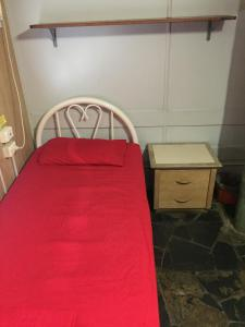 A bed or beds in a room at Cairns City Backpackers Hostel
