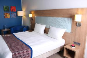 A bed or beds in a room at Quality Hotel Ostrava City